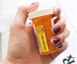 Empty pill bottle take with food