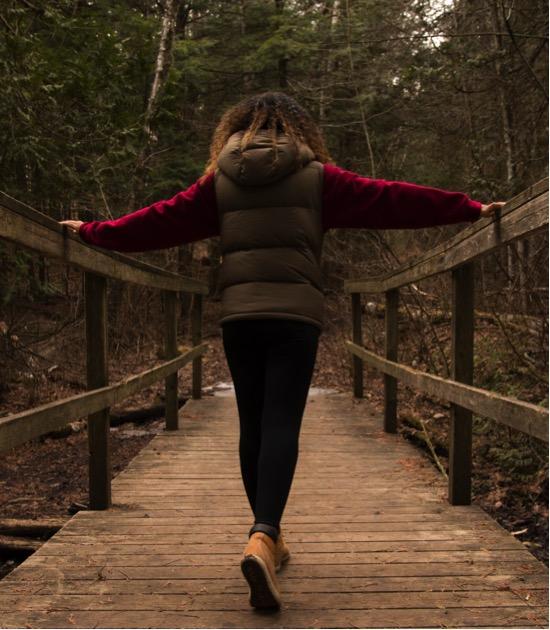 Walking over a wooden bridge