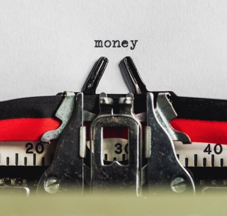 The word money typed on paper from Burst by Shopify