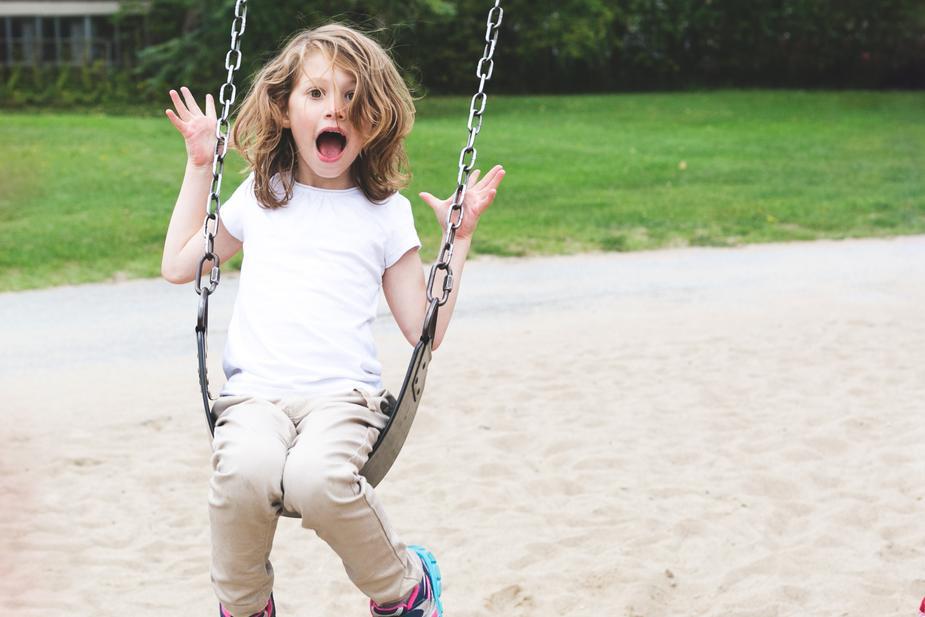 Girl plays on swing