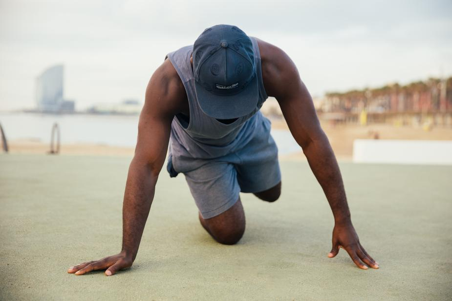 Man stretches before exercise