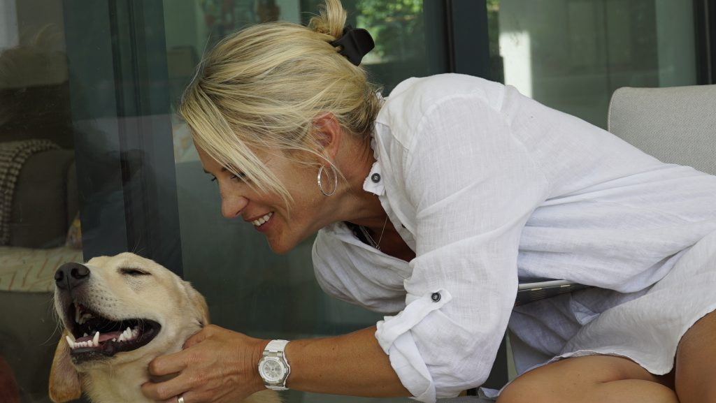 Nutritional Therapist Emma Tellett with her dog